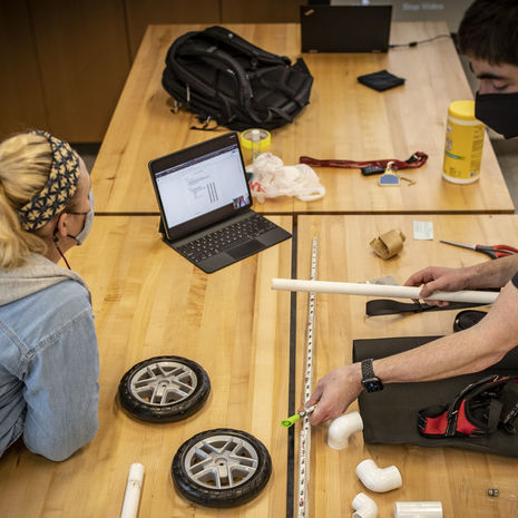 Temple students building prototype for a puppy wheelchair.