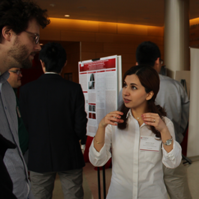 student and faculty discussing research