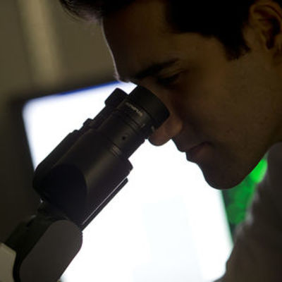 student looking in microscopr