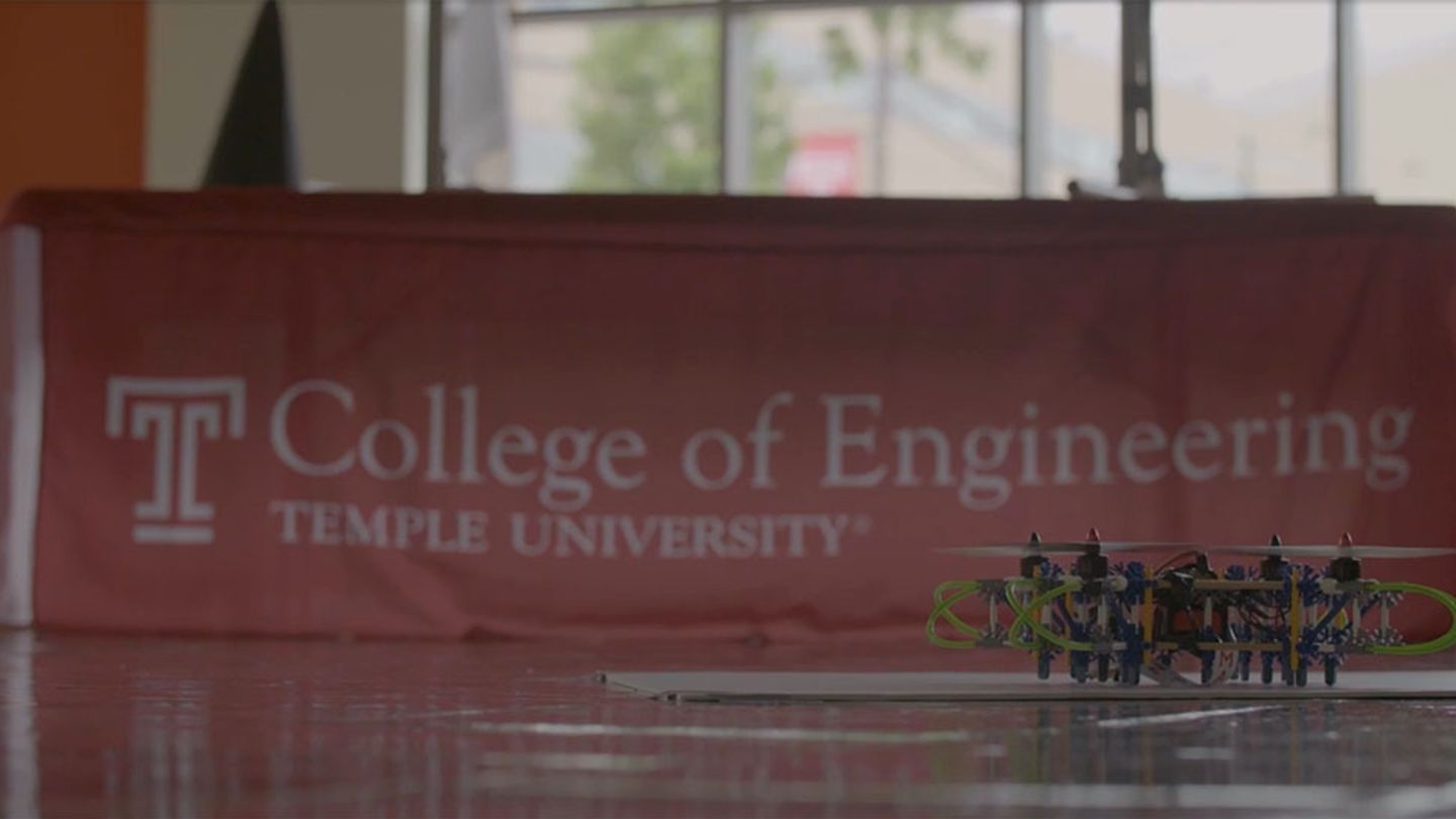 Temple College of Engineering Flag with drone in front of it