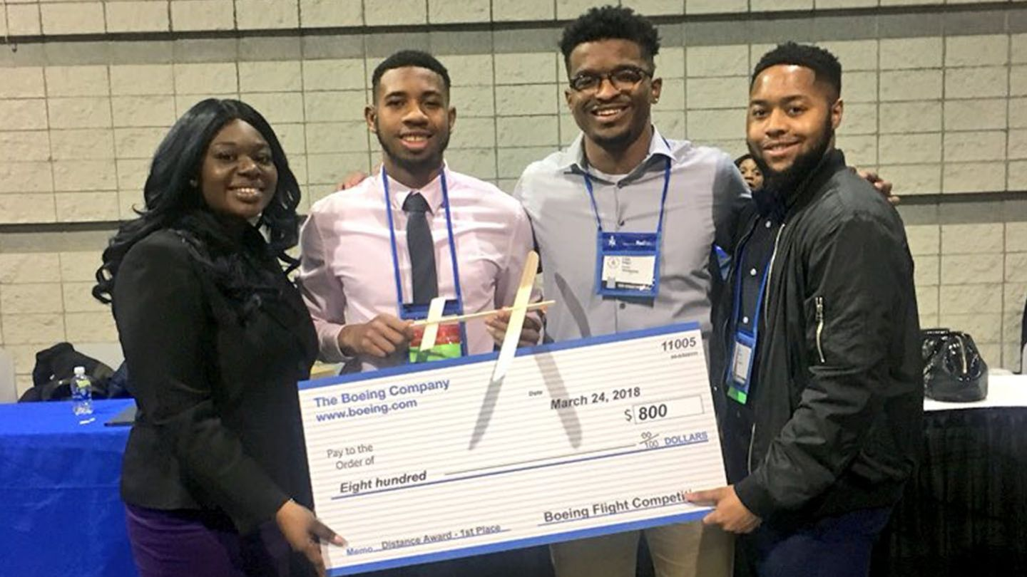 NSBE team with check