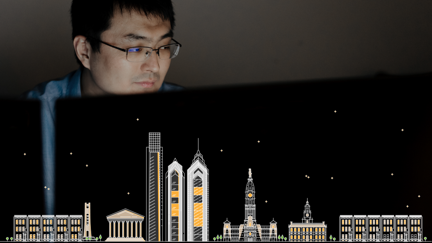 man behind computer screen with cityscape illustration below