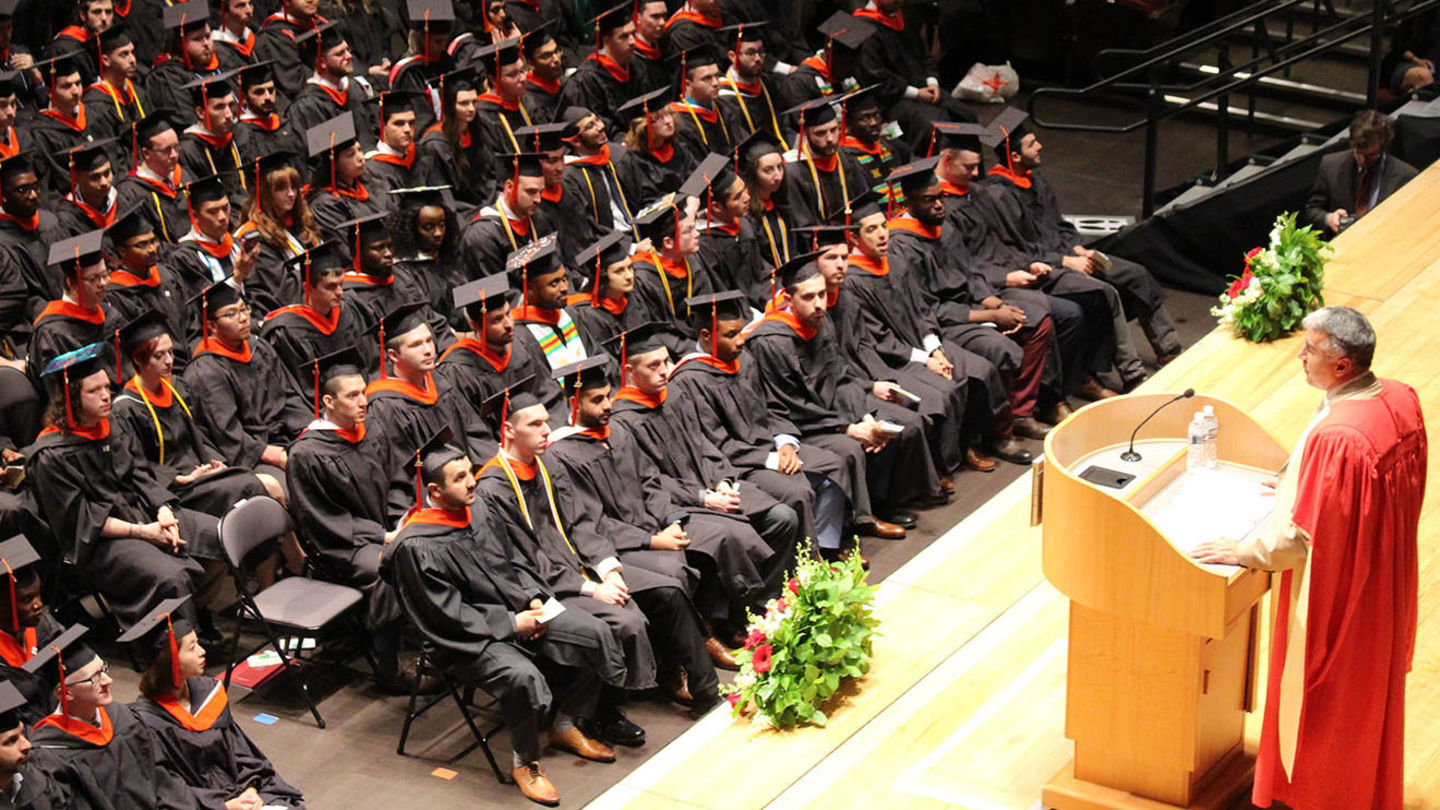Dean speaking at Commencement